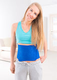 Woman wearing slimming belt Royalty Free Stock Photos