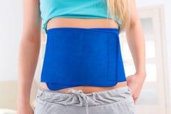 Woman wearing slimming belt royalty free stock image