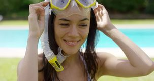Woman wearing snorkel and swim goggles stock footage