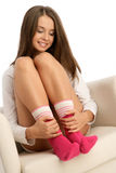 Woman wearing socks. Young woman wearing socks sitting in armchair Royalty Free Stock Image