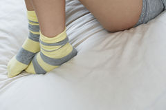 Woman Wearing Socks Lying In Bed Royalty Free Stock Images