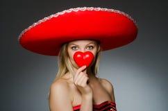 Woman wearing sombrero hat Stock Photo