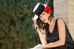 Woman wearing spanish hat and red carnations in her hair Royalty Free Stock Image