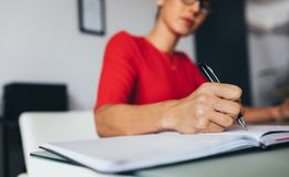 Business woman writing notes royalty free stock photography