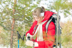 Woman wearing sport red jacket in winter forest. Stock Photos