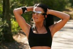 Woman wearing sports bra and sunglasses. Beautiful fit woman wearing black sports bra Royalty Free Stock Photos