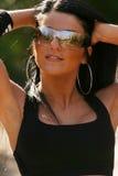 Woman wearing sports bra and sunglasses. Beautiful fit woman wearing black sports bra Stock Photos
