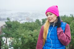 Woman wearing sportswear exercising outside during autumn Royalty Free Stock Photography