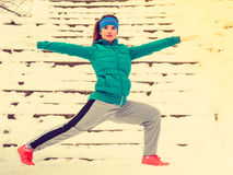 Woman wearing sportswear exercising outside during winter Royalty Free Stock Images