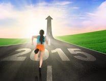Woman wearing sportswear run on the road Stock Photos