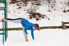 Woman wearing sportswear urban exercising outside during winter Royalty Free Stock Image