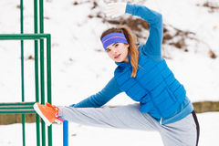 Woman wearing sportswear urban exercising outside during winter Stock Image