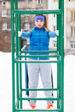 Woman wearing sportswear urban exercising outside during winter Stock Photography