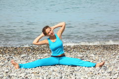 woman wearing sporty clothers is making exercise Stock Photography