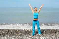 Woman wearing sporty clothers with raised hands royalty free stock images