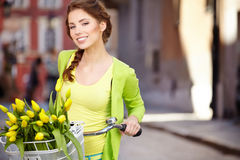 Woman wearing a spring skirt like vintage pin-up holding bicycle Stock Photography