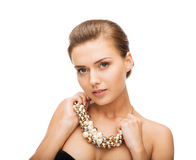 Woman wearing statement necklace Stock Image