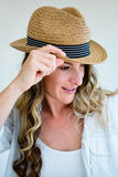woman wearing a straw fedora peering away Stock Photos