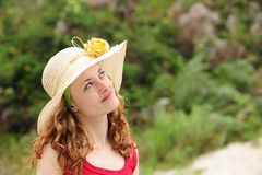 Woman wearing a straw hat Stock Photo