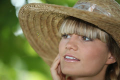 Woman wearing straw hat Stock Photography