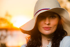 Woman wearing straw hat Stock Photos