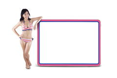 Woman wearing striped bikini with copyspace 1 Stock Images