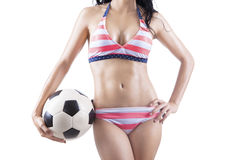 Woman wearing striped swimsuit holding ball Stock Photography