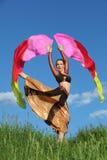 Woman wearing suit dances with pink veil fans Stock Photos