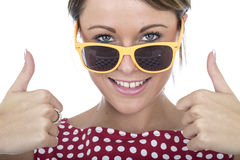Woman Wearing Sun Glasses Giving Thumbs Up Royalty Free Stock Photography