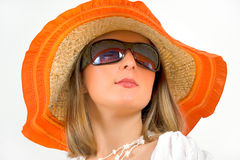 Woman wearing sun glasses and straw hat Stock Image