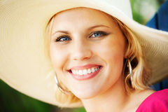 Woman wearing sun hat Stock Photo