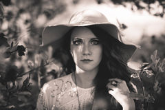 Woman Wearing Sun Hat Surrounded by the Plants Grayscale Photography Stock Photos