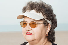 Woman wearing a sun visor Royalty Free Stock Photo