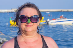 A woman wearing sunglasses against the sea Stock Photography