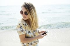 Woman Wearing Sunglasses At The Beach Royalty Free Stock Photos