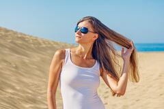 Woman Wearing Sunglasses at Beach stock photography