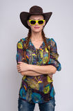 Woman wearing sunglasses and cowboy hat Royalty Free Stock Images