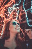 Woman Wearing Sunglasses Holding Her Hair Stock Photo