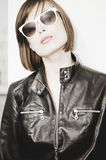 Woman Wearing Sunglasses And Leather Jacket Royalty Free Stock Image