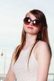 Woman wearing sunglasses looking into space and thinking. Sun, contemplation, portrait, feminity concept. Woman wearing big sunglasses looking into space royalty free stock images