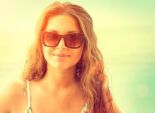 Woman wearing sunglasses over sea background Stock Photo