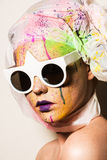 Woman wearing sunglasses. Portrait of model wearing sunglasses. Close-up portrait of young woman with unusual makeup. Model posing with paint drops over her face Royalty Free Stock Photos