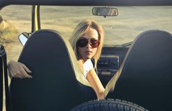 Woman Wearing Sunglasses Riding in Car Royalty Free Stock Images
