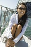 Woman wearing sunglasses on sailboat Stock Images