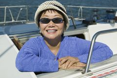 Woman wearing sunglasses on sailboat smiling (portrait) Stock Images