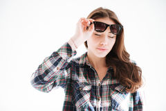 Woman wearing sunglasses standing over white background Stock Images