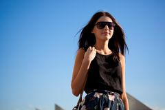 Woman wearing sunglasses walking away Royalty Free Stock Image