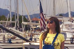 Woman Wearing Sunglasses and Yellow Top Royalty Free Stock Photography