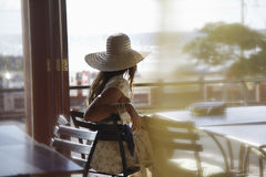 Woman Wearing Sunhat At Cafe Royalty Free Stock Image