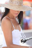 Woman wearing a sunhat Stock Image